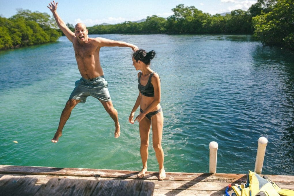 Visitors diving into some of the beautiful blue waters in the  Northwestern part of the Dominican Republic.