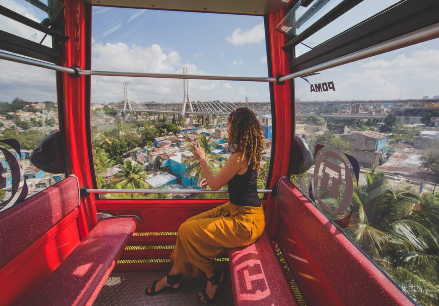 Riding and enjoying the views aboard the El Teleferico public transportation system in Santo Domingo.